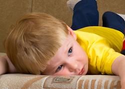 boy-sad-on-sofa-
