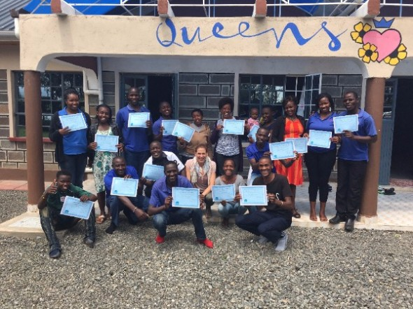 """Say DDP!"" Dr. Courtney Rennicke with the 1st graduates of DDP Level 1 Training on the entire continent of Africa! The remarkable staff at Play Kenya / Rafiki Mwema in Nakuru, Kenya."