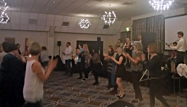 People dancing at the Ceilidh after the first day of the conference